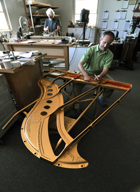 Douglas prepares the piano for stringing